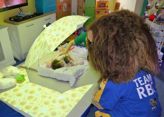 Leo the Lion watches over 2 year old Demelza resident, Melissa